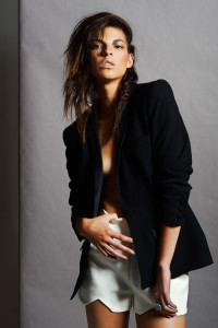 Model with long brown hair in black jacket styled by Elle Giles.