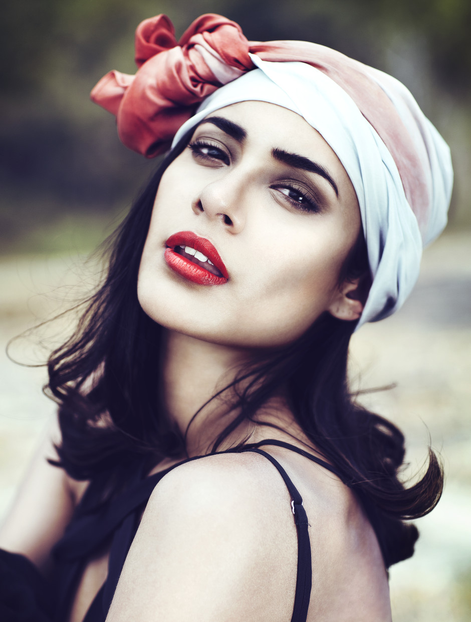 Beautiful fair skinned girl with silk bandanna and red lipstick.