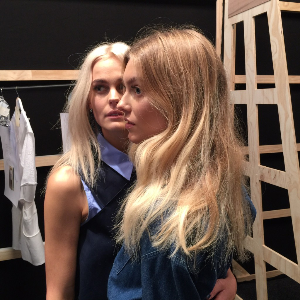 Two models waiting backstage at Watson X Watson