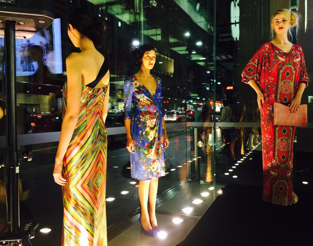 Picture of models standing in the window of the Apple store in Sydney at the launch of Leona Edmiston accessories May 2015