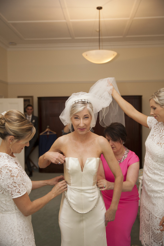 Bride and bridesmaids adding the final touches.