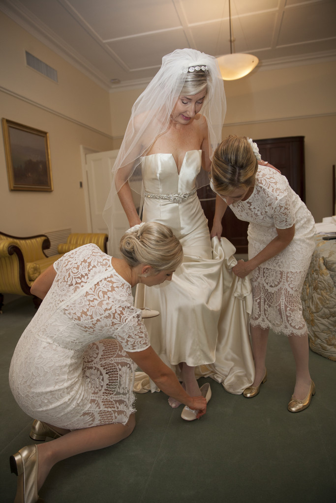 Bride and bridesmaids getting dressed. Veil from Marry Me Mosman. Diamond hair piece from Fashions by Farina, Dymocks Building, Sydney. Golding Dress from the Hero Collection, by Johanna Johnson. Bridal ballet flats by Antonio Barbato from Dominiques Shoes, Chatswood. Bridesmaids dressed in the Halo Sheath Dress in Snow, by Lover the Label. Bridesmaid gold ballet flats by Dominiques Shoes, Chatswood.