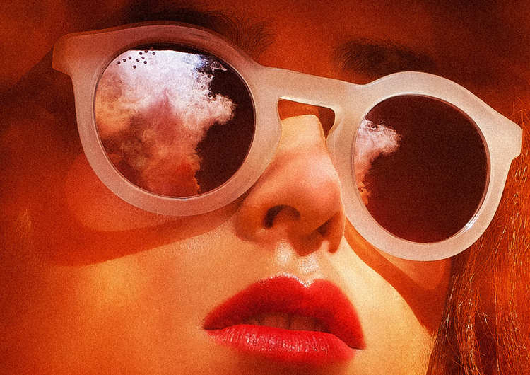 Picture of a girls face with clear round plastic sunglasses in a 1950's style showing the reflection of the surrounds in the lenses with bright red lipstick.