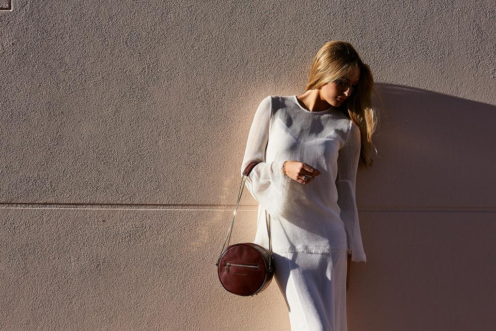 Model standing modelling a Janna Jones Handbag, designer from Perth Western Australia.