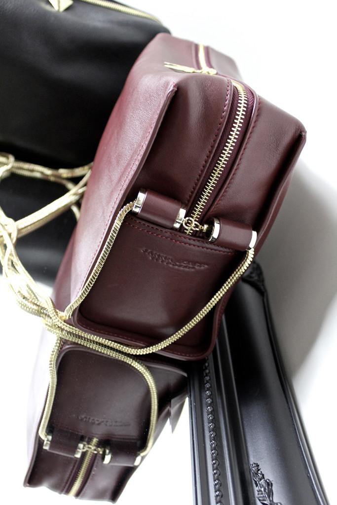 Handbags, leather in black and burgundy designed by Janna Jones of Perth Western Australia.