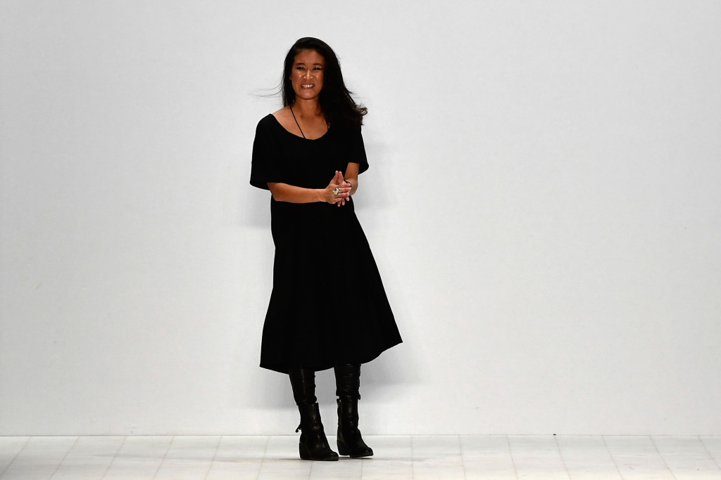 A picture of Sarah Watanabe, designer of Monster Alphabets from Perth, standing at the foot of the runway, dressed in a black dress and black boots, after her show at Mercedes Benz Fashion Week Sydney 2016 in Sydney.