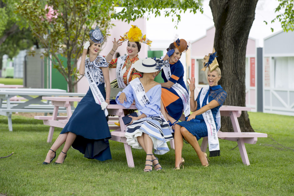 Five national competitors for the Victorian Spring Racing Carnival. Alice Bright, Courtney Moore, Inessa McIntyre, Regina Thei, Ashleigh Jane, all sitting under a tree.