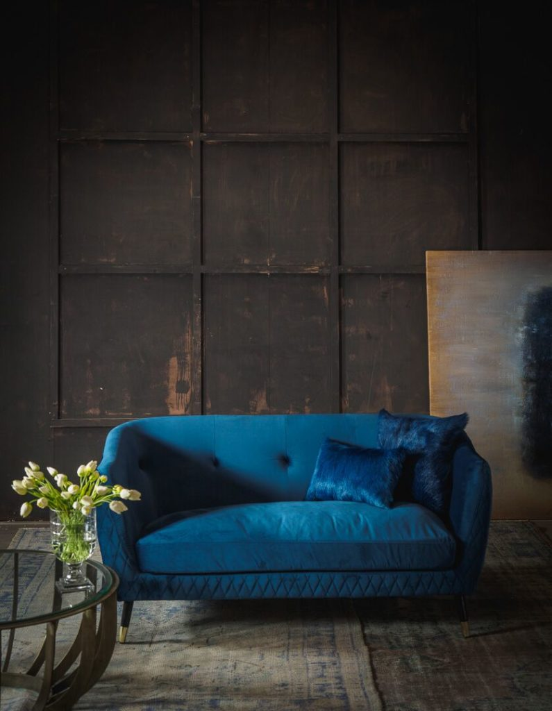 Blue velvet luxury sofa by Horgans interiors.