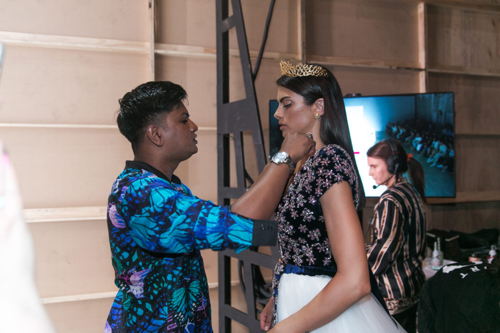 Backstage at the Aqua Blu show - final touches for the catwalk for MBFWA Resort 2020 at Carriageworks May 2019 with model, Charlie Robertson and Creative Director of Aqua Blu, Kristian Chase.